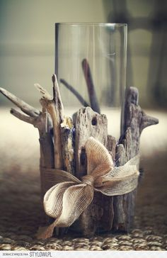 Driftwood or sticks tied with a ribbon!  Simple and sweet!