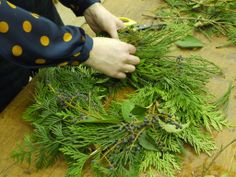 One of our crafters getting busy making her Christmas wreath.  http://www.belhavenfruitfarm.co.uk/the-store.aspx