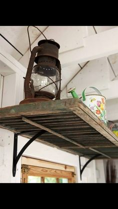 Old shutter shelf or hang it from the ceiling