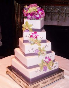 Spiral turned 5-tiered wedding cake with fresh cascading orchid clusters by The Vintage Cake. www.thevintagecake.com