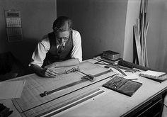Mr. Stephens at his drafting table.