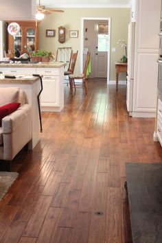 Hardwood floors are not a problem in a kitchen, especially if you use a distressed wood like this one from Hallmark's Heirloom Collection (Hickory Tea Leaf).