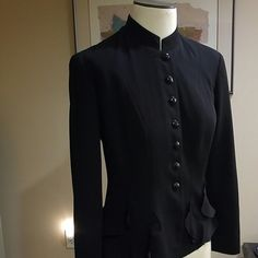Neiman Marcus Exclusive Black Fitted Jacket/Blazer Beautiful black exclusive blazer. This blazer has great detailing. Ruffles along where pockets would be and on the back at the bottom (see photo 4) and is fitted. Size 8 and has been worn a handful of times. Neiman Marcus Jackets & Coats Blazers