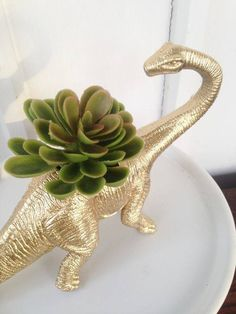 Spray paint those cheap dinos and make planters for small-rooted plants.