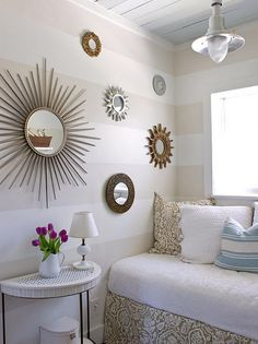 Love the sunburst mirrors and painted stripes on wall.