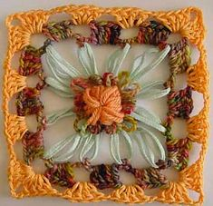 How to make granny squares with a centre made on a square flower loom. Includes…