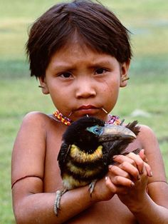 The Eyes of Children around the World Liked · August 2012 Yanomami girl holds aracari in Parima Tapirapeco National Park (Venezuela) © Art Wolfe Yanomami massacre, you can read a complete article here: