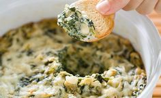 Hot Spinach and Artichoke Dip by America's Test Kitchen. Served bubbling hot from the broiler in chain restaurants' appetizer platters across the country, this creamy, cheesy dip is studded with chunks of artichokes and earthy spinach. Hot Spinach Dip, Spinach Artichoke Dip, Artichoke Hearts, Chopped Spinach, Dip Recipes, Appetizer Recipes, Appetizers, Recipies, Kitchen Recipes