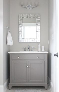 half bathroom ideas - Want a half bathroom that will impress your guests when entertaining? Update your bathroom decor in no time with these affordable, cute half bathroom ideas. Diy Grey Bathrooms, Grey Bathroom Vanity, Gray Vanity, Upstairs Bathrooms, Downstairs Bathroom, Bathroom Renos, Bathroom Small, Mirror Bathroom, Gray And White Bathroom Ideas