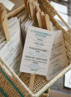 the wedding ceremony programs on fans...like this for our outdoor wedding!