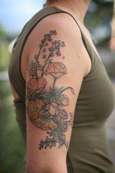 Wonderland Tattoos - Stunning floral arrangement by Kirsten Holliday. Larkspur, milkmaids, california poppies, flannel bush, fairy lanterns, and daisies.