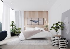 Character can shine in a muted bedroom – if only one knows how to accent appropriately. This bedroom's wooden feature wall and shafts of white allow striped laundry baskets and daring illustrations to dominate.
