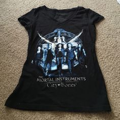❗️BOGO 1/2 off❗️The mortal instruments tee Size small black mortal instruments t-shirt. Size small and in great condition! Tops Tees - Short Sleeve