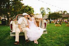 Americana Wedding - bride and groom kissing on pickup truck (photo: michelle gardella)