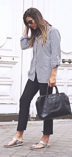 Striped button up, with sleeves rolled, skinnies, and slip-on sandals. You can do this.