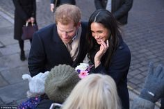 Harry and Miss Markle engaged in conversation with the woman as they carried out their visit