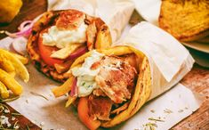 If you've ever tried souvlaki and gyros you'll know it's an unforgettably delicious Greek street food. Here are 10 facts that make it so tasty! Spanish Dishes, Greek Dishes, Greek Recipes, New Recipes, Greek Meals, Halloumi Burger, Salsa Tzatziki, Greek Sauce, Greek Gyros