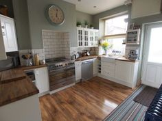 Oven set into chimney breast, cupboards either side and tiling behind. White cupboards and butchers block worktops. Kitchen Interior, Kitchen Wall Colors, Colorful Kitchen Decor, New Kitchen, Victorian Kitchen, Home Kitchens, Wall Oven Kitchen, Kitchen Chimney, Kitchen Design