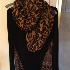 Black tunic style long sleeve top w/ tribal detail This is a long tunic style top in excellent condition. Gorgeous quality--marked size S but could also work for a size M in my opinion. It covers your rear in the back, and the detailing on the front immediately slims any figure!  Tops