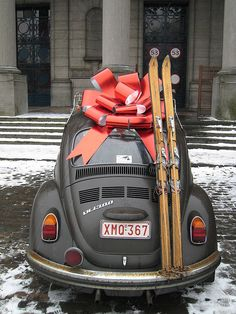 Gift VW... skis... bow... black beetle... snow... wish someone would leave a package like this at my house.  :)