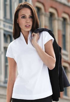 0c0d47c4f9205 This fashionable and functional polo shirt is made for women and features  cool-logik technology