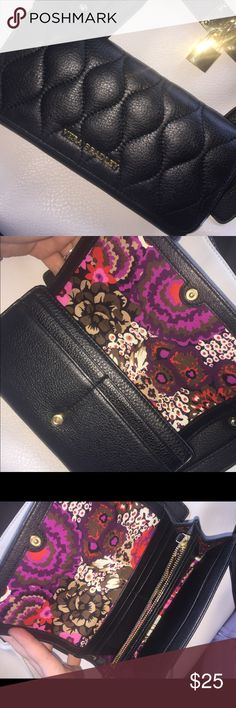 VERA BRADLEY WALLET This pretty spring wallet is perfect for you! Black quilt on the outside. With 12 spots to hold your various cards, a zipper pocket and 3 extra spaces to put money or whatever you desire!! Vera Bradley Bags Wallets