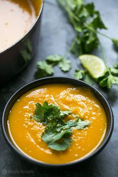 Roasted kabocha squash soup, thick and creamy, with ginger, cumin, and coriander. Perfect for fall! ~ SimplyRecipes.com #paleo #glutenfree
