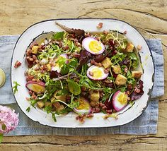 Egg, beetroot  bacon salad. These purple, beetroot-dyed eggs are a pretty addition to a main course salad, especially when teamed with spring leaves and a punchydressing