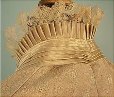 detail of c. 1882 2-piece Trained Light Taupe Silk Crepe and Satin Two-Tone Dinner Gown with Golden Silk Taffeta Trim and Train