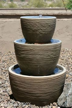Tiered Flower Pot Fountain:  Using some pots from Lowes, a $5 water pump, and some rocks from around her yard, blogger Katie created this simple, relaxing water fountain for her garden that birds can't get enough of.