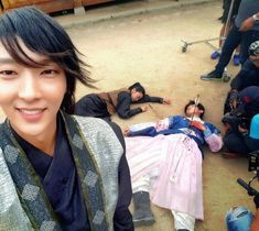 "Lee Joon-ki takes picture on ""Scarlet Heart: Ryeo"" set"