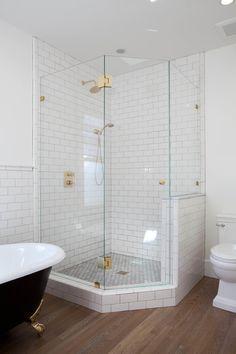 White subway tile inside corner glass shower | Kim Grant Design