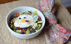 All the great flavors the classic Huevos Rancheros dish is known for have been combined to create this chopped salad that's packed full of protein and fiber. Substitute queso fresco for pepitas or extra avocado, if desired.