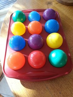 Easy activity for 1 year old - Colour balls in a silicone muffin tray, they'll put colours together, move them around etc. This helps with colours, maths (numbers, categorizing,  fitting shapes) and is bright, fun and little mess for us! :-)