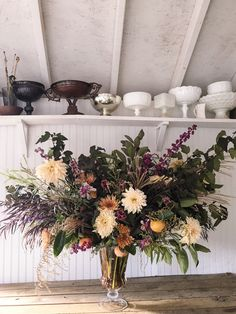 Large urn grown and designed by Love 'n Fresh Flowers. We could do something like this for the ceremony.
