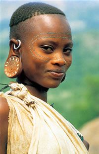 "Africa |  Surma woman, lower Omo, Ethiopia. | ©Carol Beckwith and Angela Fisher.  One of the lovely images included in their book of postcards "" Women of the African Ark"""