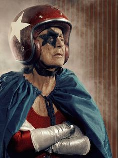 French photographer Sasha Godlberger decided to cheer up his depressed 91-year-old grandmother Frederika by featuring her in a series of portraits. Transforming his lonely grandmother into a spandex-clad super-heroine complete with a cape, crash helmet and the occasional puppy sidekick.