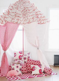 Madeline Weinrib Pink Morning and Carnation Suzani Pillows, Pink Daphne Ikat Pillow, and Hot Pink Lupe Cotton Carpet
