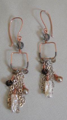 Really neat earrings. Those look like homemade hooks, too.