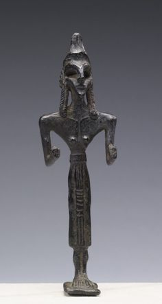 Female Votive Figurine of Anat  Levantine (in present-day Syria), early 2nd millennium BC (Middle Bronze Age (MB I/II A))   (19.5 x 5.9 x 3.3 cm)   This solid cast bronze figurine served as votive offering and is surely Anat, a fertility goddess who is the sister and consort of Baal.  (In the Walters Museum of Art)