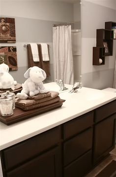 Boys Bathroom re-do from The Yellow Cape Cod-like the tray idea with towels, cotton balls and q-tips in clear jars.