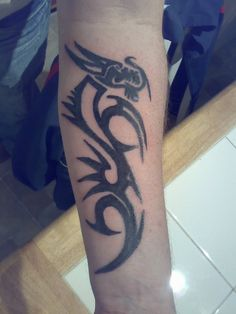Tribal inspired tattoo – tribal dragon tattoo