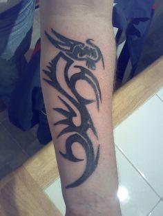 Tribal inspired tattoo – tribal dragon tattoo