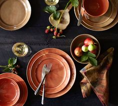 Next to plain white dishes, our richly colored dinnerware brings warmth and appetizing ambiance to every meal. The glazed stoneware with visible natural undertones and rubbed edges is handcrafted in Portugal with an artisan-made look and feel. Choose a single color or make it fun by layering mixed colors according to the mood and menu.