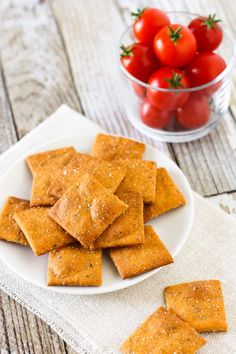 Tomatoes, garlic, oregano and basil. A crispy, gluten free cracker that has all the herbs and flavors of a slice of pizza. Yes, please! These are great for snacking and perfect for lunchboxes. // @SarahBakesGFree