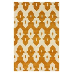 Create a chic focal point in your foyer, den, or master suite with this hand-tufted wool rug, featuring a tessellated motif in mustard. Made in India.