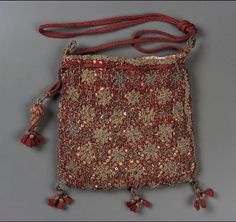 Drawstring bag      English, late 16th–early 17th century       England  Dimensions      Overall (without tassels and cord): 14 x 14.5 cm (5 1/2 x 5 11/16 in.)  Medium or Technique      Silk; twill, silk knotted net with gold metallic needle lace embroidery, spangles and wire; braided silk and metallic cords and tassels  Classification      Personal accessories   Accession Number      38.1230