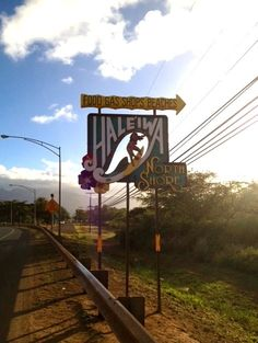 Haleiwa Hawaii...every now and then, some fools actually cut down and steal this iconic sign, eventually it's returned...after all, where would you show it? So stupid!