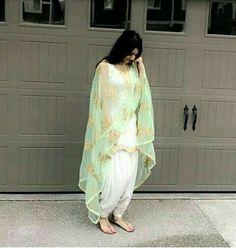 Image may contain: 1 person White Punjabi Suits, Indian Suits Punjabi, Punjabi Salwar Suits, Indian Attire, Salwar Kameez, Indian Wear, Indian Lehenga, White Suits, Patiala Suit Designs