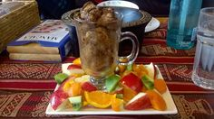 Cinnamon french toast squares (that steamed up the glass) surrounded by apple, kiwifruit, orange and apricot